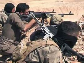 Kurdish fighter battling ISIL near Kurd border. Don't forget the Kurds - the third part of that equation!
