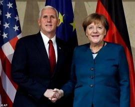 United States Vice President Mike Pence, left, and German Chancellor Angela Merkel meet for bilateral talks during the Munich Security Conference in Munich, Germany, Saturday, Feb. 18, 2017. The annual weekend gathering is known for providing an open and informal platform to meet in close quarters. (AP Photo/Matthias Schrader)