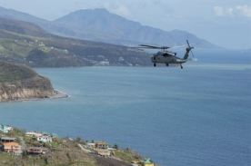 Helicopters attached to the amphibious assault ship USS Wasp survey damage over the island of Dominica.